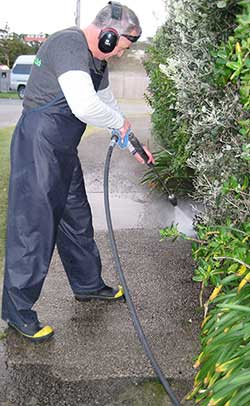 Path pressure washing in progress